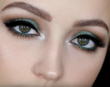 A girl with green eyeshadow