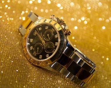 a photo of a golden mans watch